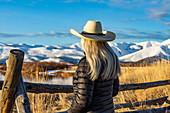 Senior woman in cowboy hat looking at view, Sun Valley, Idaho, USA