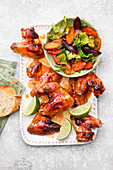 Asian chicken wings with lukewarm carrot salad