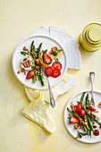 Green asparagus and strawberry salad with toasted chocolate