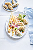 Dumplings with white asparagus and wasabi cream
