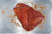 Raw beef brisket with jerk spice mix