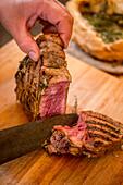 Porterhouse steak grilled in a salt crust, sliced