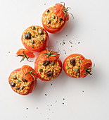 Tomatoes filled with rice, capers and olives