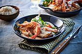 Light ragout with turkey leg and prawns