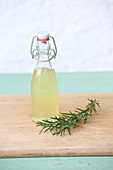 Rosemary hydrosol (extract) in a small flip-top bottle