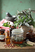 Tinctures of sage and rose petals in glass jars