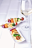 Grilled vegetable kebabs with tofu and pimientos