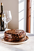 Chocolate layer cake with dulce de leche butter cream and ganache