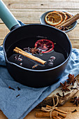 Mulled wine with cinnamon stick and dried oranges