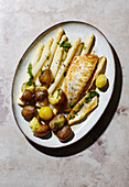 Fried zander fillet with asparagus, potatoes and wild garlic butter