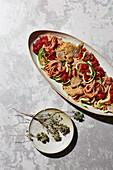 Courgette pasta with Parmesan pork escalopes