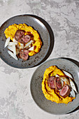 Saddle of venison with black salsify and mashed pumpkin