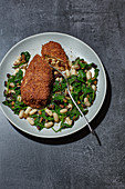 Aubergine cordon bleu with a spinach and bean medley