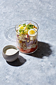 A layered salad in a jar to go