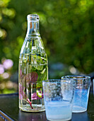 Herb flavoured water in a bottle and two glasses