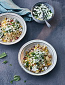 Warm couscous salad with pomegranate and sheep's cheese