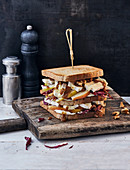 A club sandwich with pears, radicchio, Brie cheese and walnuts