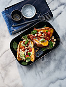 Gratinated sweet potatoes with blue cheese and nuts