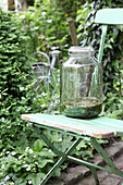 Approach for herbal tincture in a large swing glass on a garden chair