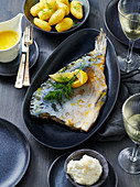 Blue carp with salted potatoes