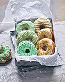Colourful doughnuts in a gift box