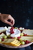 Cheese plate with ripe red currant