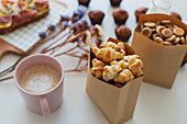 Paper bag with yummy sweet mini croissants and mug of hot aromatic coffee