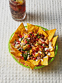 Indian nacho chaat with chickpeas and yoghurt