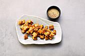 Marinated tofu with tahini and sesame seeds