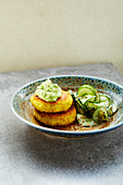 potato and millet fritters with pea dip and a cucumber salad