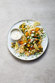 Fried vegan carrot and kale with wholemeal bulgur and soya yoghurt dip