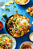 Chilaquiles with black beans, corn, tortilla chips and fried eggs