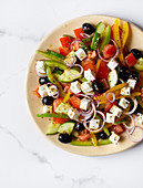 A farmer's salad with feta cheese and black olives
