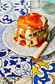 Francesinha (Portuguese toasted sandwich with meat, cheese, a fried egg and gravy)