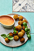 Vegetarian bean balls in a tomato and coconut sauce (Portugal)