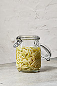 A jar of pickled fennel with pastis