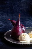 Red wine pears with vanilla ice cream