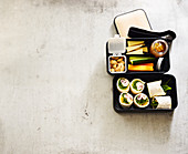 Bento snack box with tortilla wraps and vegetables crudités