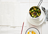Spinach and grilled bread salad with boiled eggs and blueberries