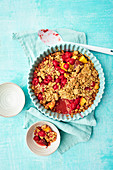A raspberry and peach crumble topped with oat crumbles