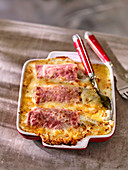 Chicory and ham gratin in a baking dish