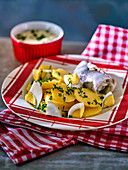 Rollmops with potato salad and egg