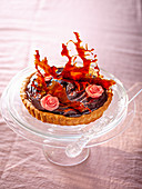 Chocolate tart with caramel and fondant rose petals