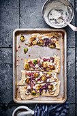 Tarte flambée with red onions and Brussels sprouts