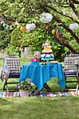 Colourful table with nappy cake and garlands for a baby shower party