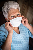 Woman wearing protective mask during Covid-19 pandemic