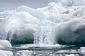 Water coming of an iceberg, Antarctica