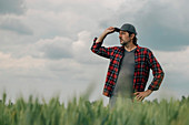 Wheat farmer looking at his field