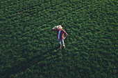 Wheat farmer looking over wheatgrass field