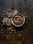 Gluten free flax seed crackers on wooden cutting board with ingredients